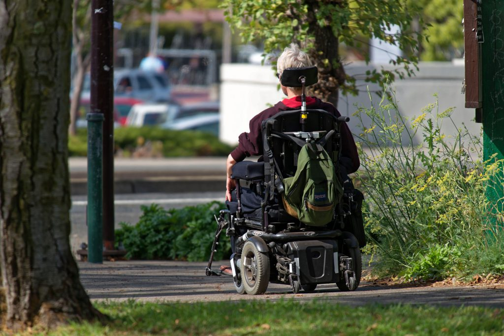 motorized wheelchair 952190 1920 1024x683 How To Care For Someone With Multiple Sclerosis, HomeTouch Blog