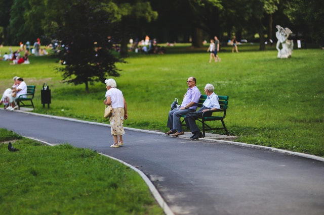 bench man people woman Gadgets to Help Your Elderly Loved One Outside, HomeTouch Blog